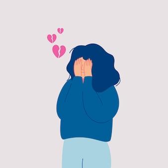 Mujer joven triste desesperada con el corazón roto llora tapándose la cara con las manos. dibujado a mano estilo ilustraciones de diseño vectorial.