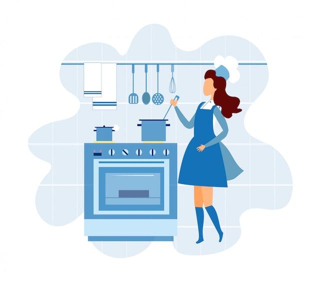 Mujer joven en uniforme de cocinero cocinando en la cocina