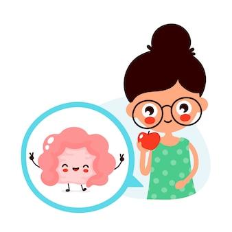 La mujer linda joven come la fruta de la manzana. feliz lindo intestino en círculo.