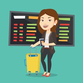 Mujer con maleta y boleto en el aeropuerto.