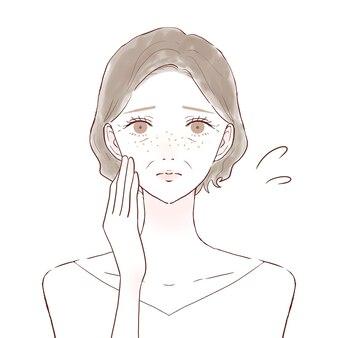Mujer de mediana edad que se preocupa por las pecas. sobre un fondo blanco.