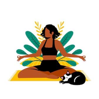 Mujer meditando junto a su gato