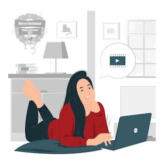 Mujer mirando una película en un portátil en el suelo