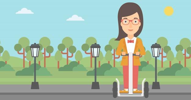 Mujer montando en scooter eléctrico.