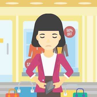 Mujer mostrando billetera epmty