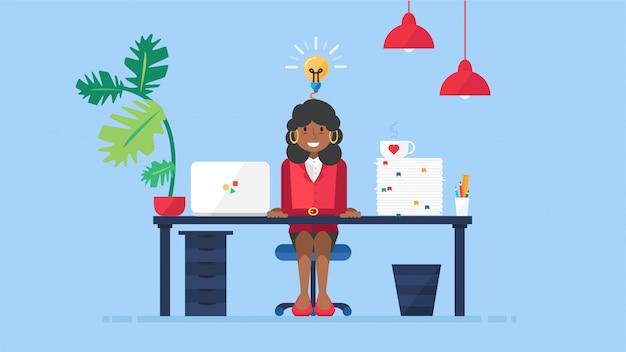 Mujer de negocios africana tiene nueva idea en el lugar de trabajo