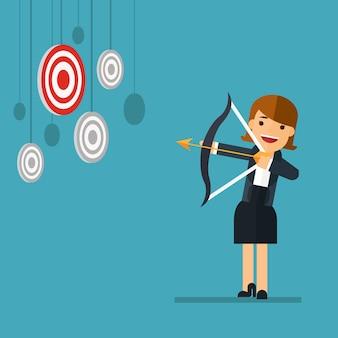 Mujer de negocios apuntando a un objetivo alto