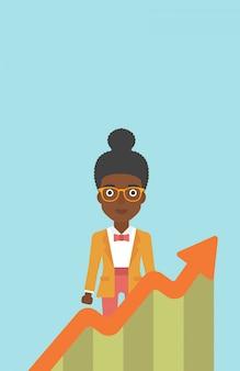 Mujer de negocios con la carta de crecimiento.