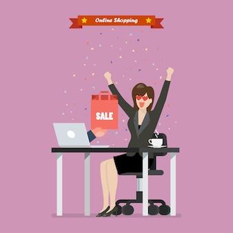 Mujer de negocios de compras en línea en una computadora portátil