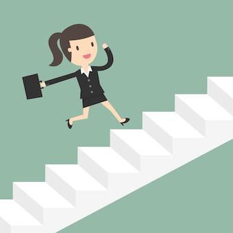 Mujer de negocios corriendo sobre unas escaleras