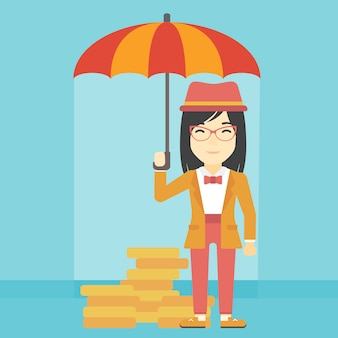 Mujer de negocios con el dinero de protección del paraguas.