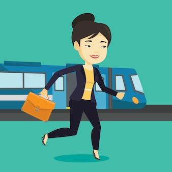 Mujer de negocios, en, estación de tren