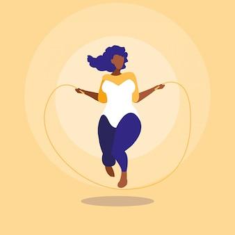 Mujer negra grande que ejercita el poder positivo del cuerpo