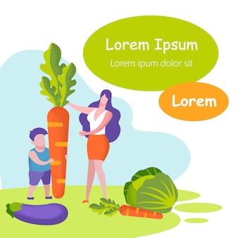 La mujer y el niño en el jardín cosechan verduras.
