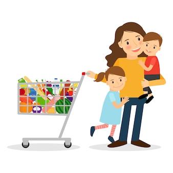 Mujer con niños y carrito de compras.