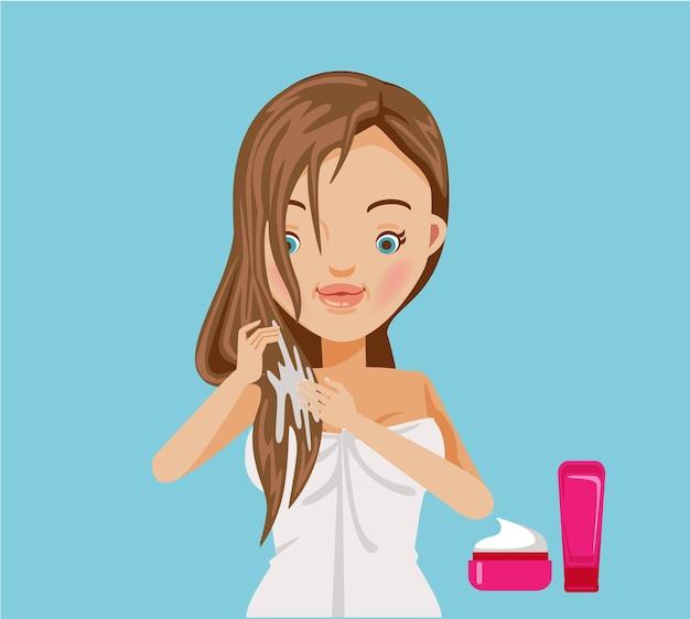 La mujer nutre su cabello con una variedad de tratamientos.