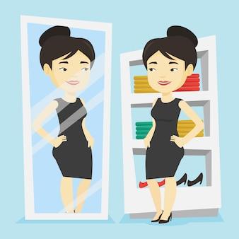 Mujer probándose ropa en el vestidor.