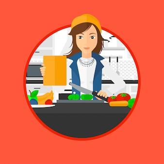 Mujer que cocina la ensalada vegetal sana.