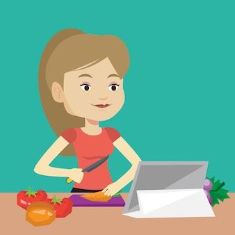 Mujer que cocina la ensalada de verduras saludable.