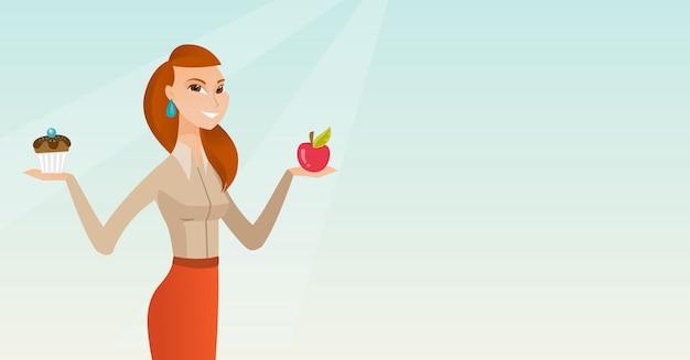 Mujer que elige entre la manzana y la magdalena.