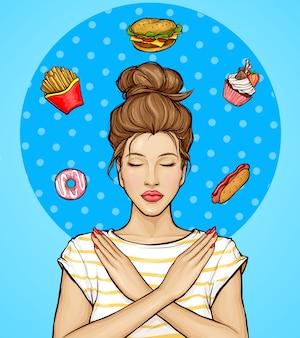 Mujer que se niega a comer comida rápida y dulces