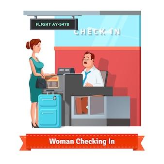Mujer que registra en el aeropuerto con el vendedor