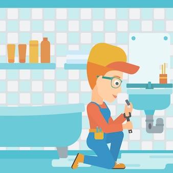 Mujer que repara el fregadero.