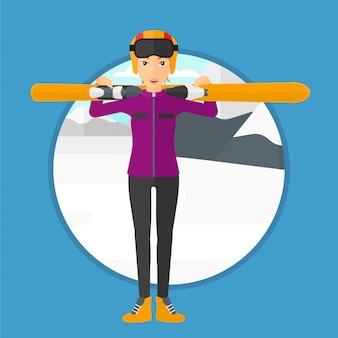 Mujer que sostiene los esquís.