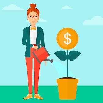 Mujer regando flor de dinero.