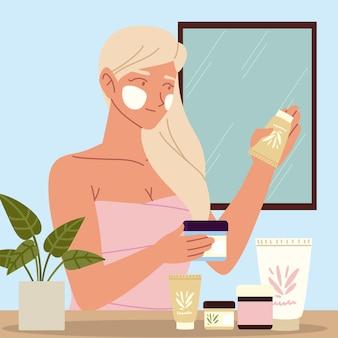 Mujer rubia cosmética cuidado de la piel del uno mismo