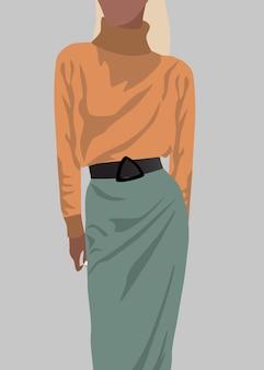 Mujer rubia vestida con suéter naranja y falda verde.
