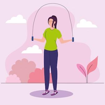 Mujer saltar la cuerda al aire libre, ejercicio de recreación deportiva