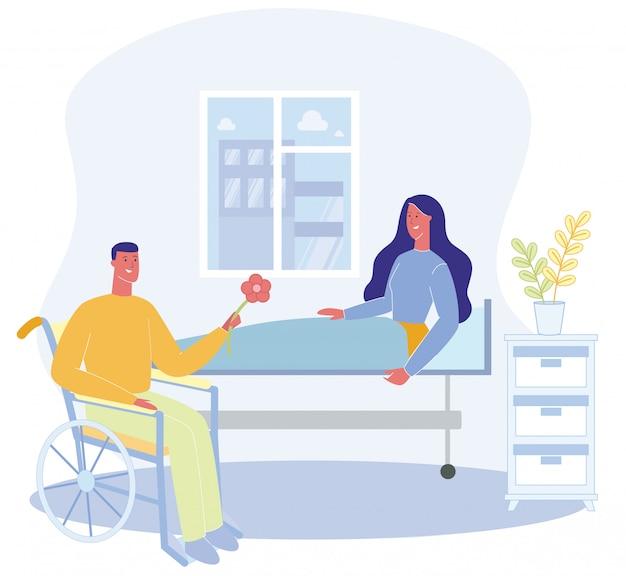Mujer sentada en la cama hospital ward hombre en wheelchai