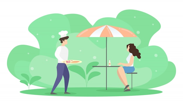 Mujer sentada a la mesa en summer cafe bajo la orden de espera de paraguas.