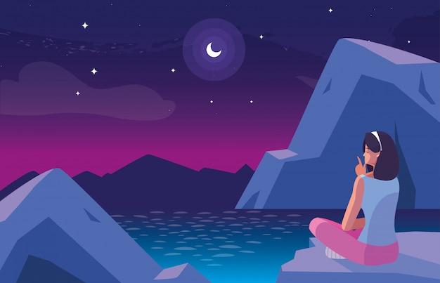 Mujer sentada observando paisaje nocturno con lago