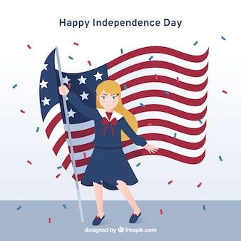 Mujer sosteniendo bandera americana