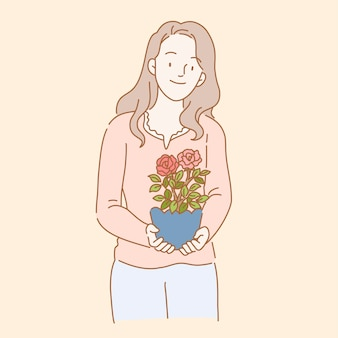 Mujer sosteniendo una planta de rosas en estilo de línea