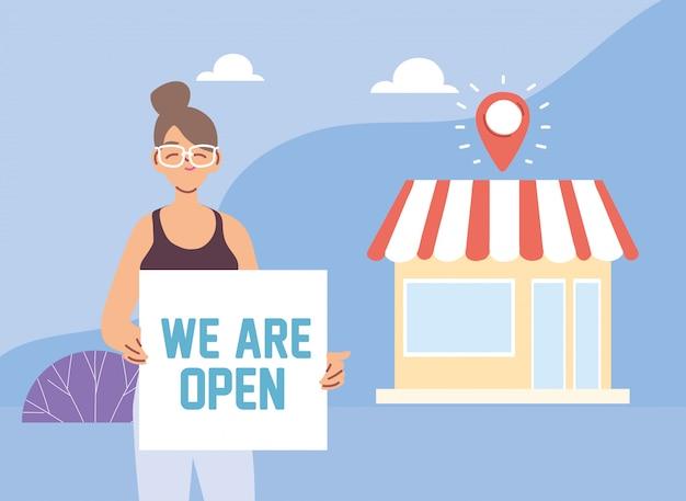 Mujer en su negocio local con banner abierto