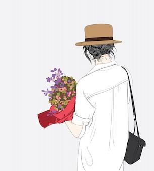 Una mujer tiene muchas flores para un gran regalo.