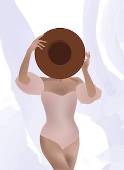Mujer en traje de baño sosteniendo un sombrero delante de su rostro.