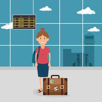Mujer turista con maleta en el aeropuerto