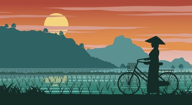 Mujer vietnamita mantener bicicleta a pie