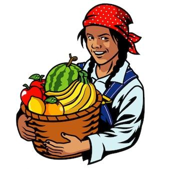 Mujeres agricultoras sostienen una canasta de frutas.
