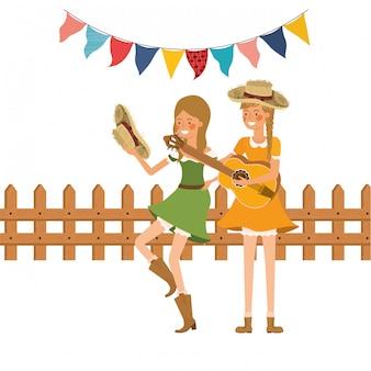 Mujeres campesinas con instrumento musical.