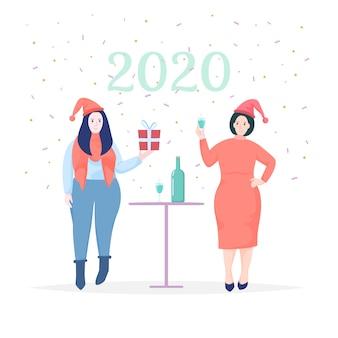Mujeres celebrando la tarjeta de felicitación de año nuevo 2020