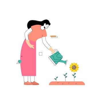 Las mujeres cultivan girasoles en el jardín en primavera