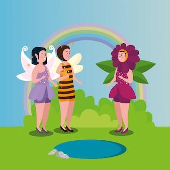 Mujeres disfrazadas de abeja y flor con hada en escena mágica