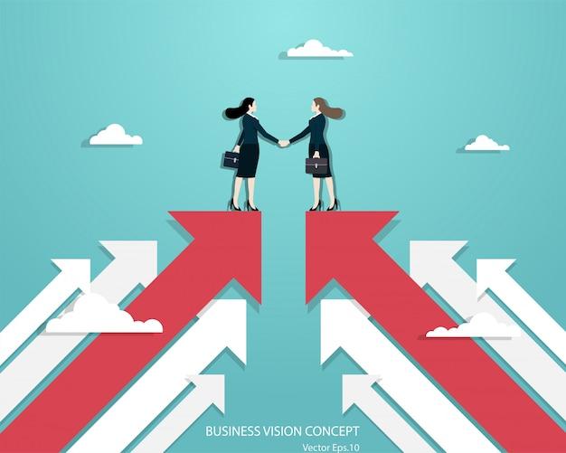 Mujeres empresarias socios apretón de manos sobre negocios