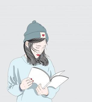Las mujeres están leyendo los libros de preparación para el examen en el invierno.