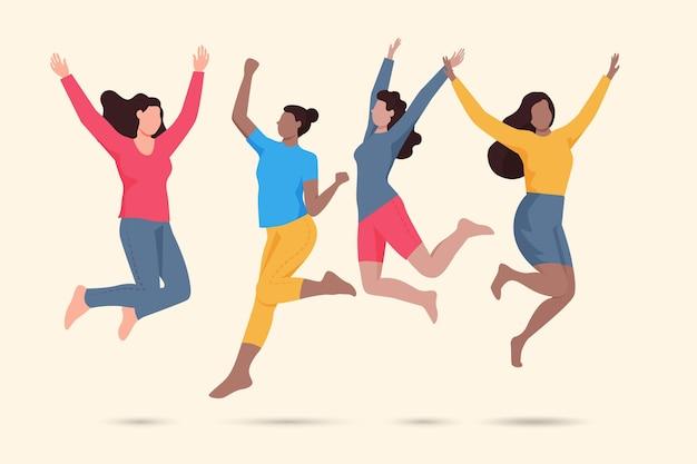 Mujeres felices saltando evento del día de la juventud